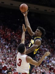 Iowa's Tyler Cook, top, shoots over Indiana's Justin Smith during the first half of an NCAA college basketball game, Monday, Dec. 4, 2017, in Bloomington, Ind. (AP Photo/Darron Cummings)