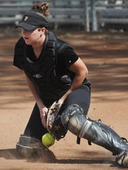 Newbury Park High catcher Serena Huchingson blocks a throw to the plate during Friday's practice.