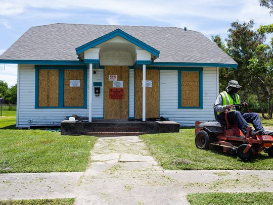 The lawn is cut of a empty home in Corpus Christi's