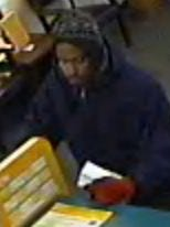 """The suspect is described as a roughly 25-year-old,  5-foot-10-inch tall black male with an average build. He was last seen wearing a """"beanie-style"""" hat and a dark blue hooded sweatshirt."""