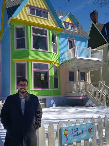 Alex Pereira stands in front of his latest rehab project,