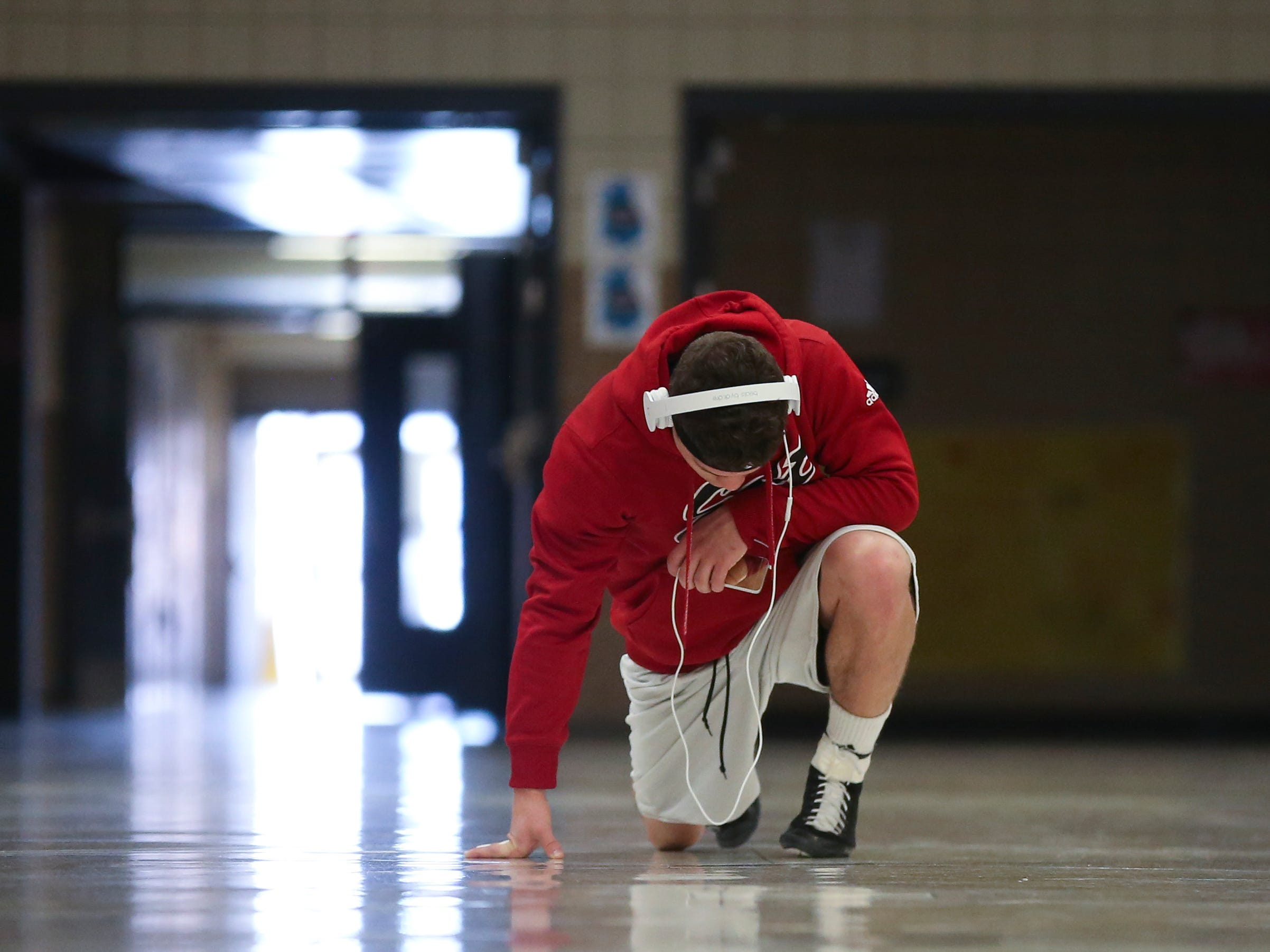 """An internal fire is pushing East 152-pound wrestler Josh Davis toward a top seed at this week's Class 3-A state wrestling tournament in Des Moines. """"Honestly, I just want people to know I have the ability to do it. There's so many people out there who doubt me for whatever reason,"""" he said. """"I just want to show them what I've got."""""""