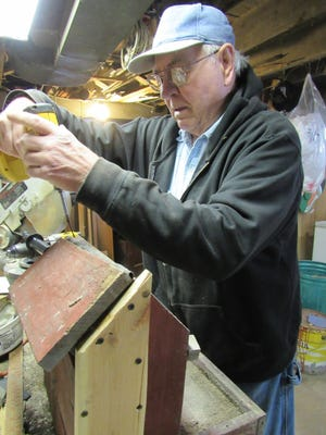 Bob repairs a bird feeder that was damaged by unknown night visitors.