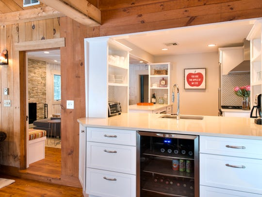 A small refrigerator in a family room gives kids easy