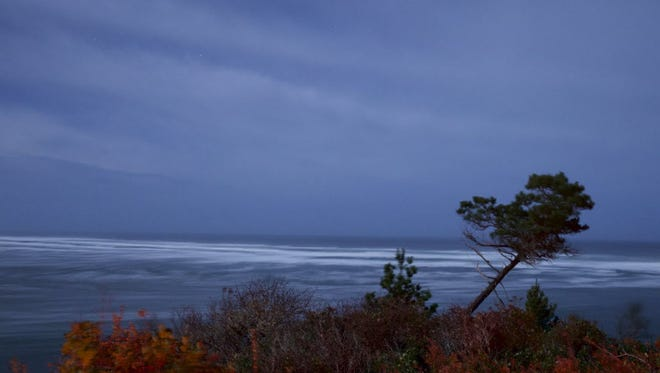 Clouds move off the Pacific to near Oceanside, Ore., Thursday, Dec. 11, 2014. The second of two storm pulses moved inland through western Oregon on Thursday, cutting off power, felling trees and sending outdoor holiday decorations flying.