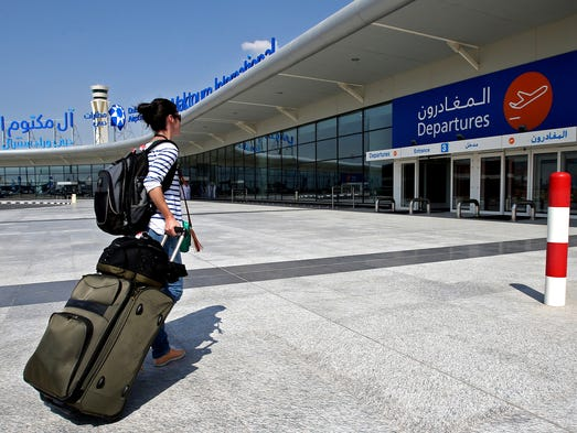 A traveler arrives at the newly opened Al Maktoum International Airport in Dubai, United Arab Emirates, on Oct. 27, 2013.