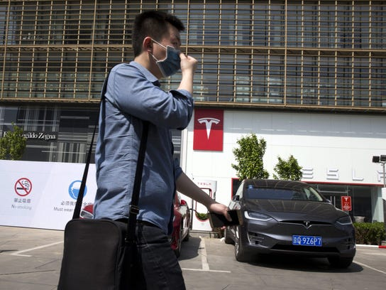 AP_China_Electric_Car_Dreams
