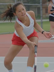 West Lafayette's Minsun Kim digs for the ball in doubles competition Tuesday at the Hoosier Conference Girl's Tennis Tournament.