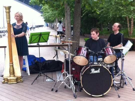 Laura Dishong is shown here at the Make Music Philly Fest in June with Michael Belay on drums and her husband Mark Dishong on keyboard, is a Moorestown teacher, who recently released a CD.