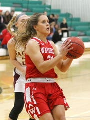 Wendi Hammond takes a shot for Waverly on Friday in