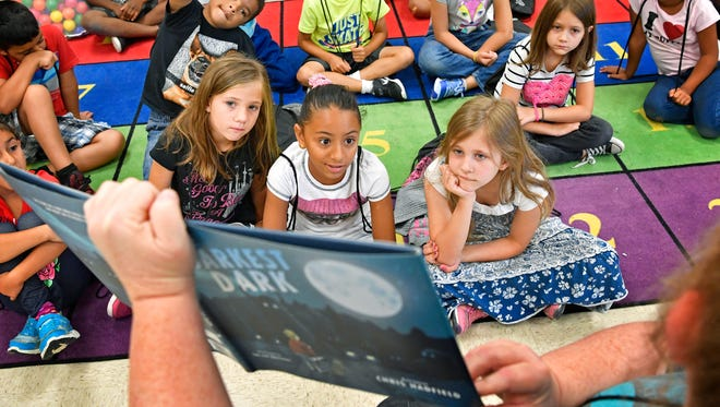 Students listen to a story being read by Paula Hodge during activities of summer reading camp at Rutland Elementary who are among the approximate 200 schools in Tennessee holding summer reading camps for grades 1-3 as part of a $30 million statewide grant provided by the Department of Human Services. Wednesday June 21, 2017, in Mt. Juliet, TN