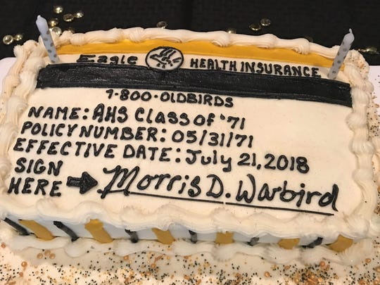 A cake prepared for the AHS 1971 reunion noted the group becoming eligible for health benefits.