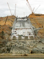 Work continues to repair the damaged main spillway