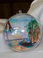 A Louisiana swamp scene is depicted in this ornament by an Opelousas art student.