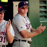 Detroit Tigers manager Larry Parrish, right, works Sept. 5, 1999, in Oakland, Calif.