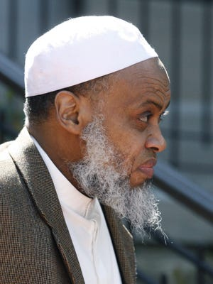 FILE - This May 11, 2012, file photo, Portland Imam Mohamed Sheikh Abdirahman Kariye, who is one of 15 men who say their rights were violated because they are on the U.S. government's no-fly list, leaves the United Sates Court of Appeals following oral arguments on the ACLU No Fly List challenge, in Portland, Ore. U.S. authorities are seeking to revoke the citizenship of the Oregon imam who they say tried to conceal past associations with radical Islamic groups. (AP Photo/Rick Bowmer, File)