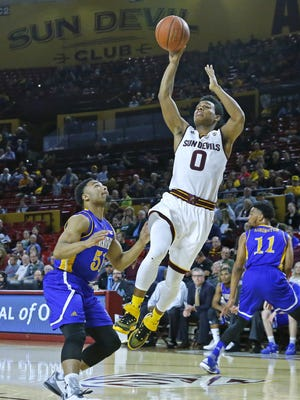 Arizona State Sun Devils guard Tra Holder (0) shoots against Cal State Bakersfield Roadrunners guard Justin Pride (51) during the first half of their NCAA basketball game Monday, Dec. 28, 2015 in Tempe, AZ.
