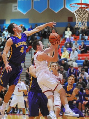 Watertown's Nate Davis (left) looks to block the shot of Lincoln's Nolan Burchill. Davis was named to the Class AA all-state first team, while Burchill is a second team honoree.