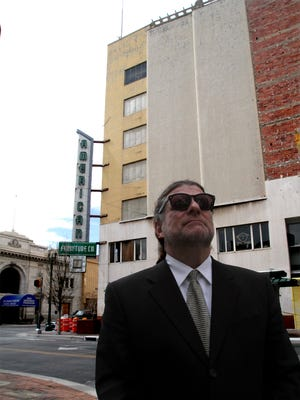 """This 2010 photo shows William """"Billy"""" Abraham in front of his seven-story American Furniture building at Oregon Street and San Antonio Avenue in Downtown El Paso."""