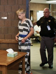 19-year-old Andrew David Willson heads in for an arraignment hearing Monday, Sept. 11, 2017, in Ingham County Magistrate Mark Blumer's office on charges of open murder and felony firearm possession in the killing of his mother, Lisa Marie Willson on Sept. 8, 2017, in Wheatfield Township.