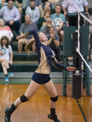 Sadie Baltz (5) strikes the ball during the Gulf Breeze vs Catholic high school volleyball game at Catholic High School in Pensacola on Tuesday, October 10, 2017.