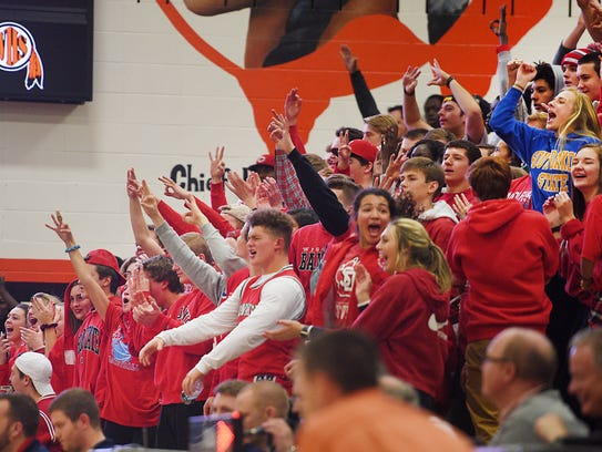 Lincoln's student section cheers after a point is made