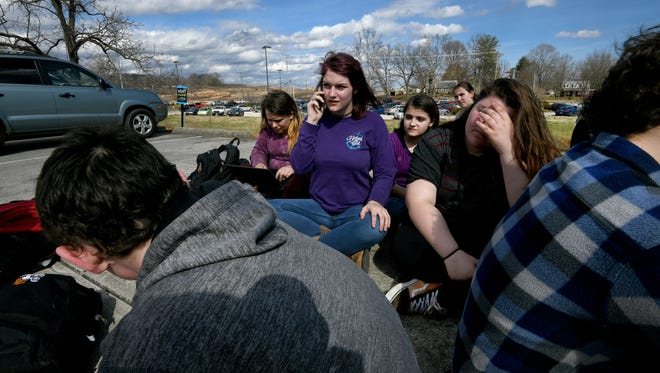 After about 100 students at Lenoir City High School participated in a walkout Tuesday, Feb. 20, 2018 to discuss fears and solutions around school shootings about a dozen decided to remain out of class. Sophomore Larn Seyfried, center on phone, said the students would not have been able to participate in a planned national walkout March 14, because it's during Lenoir City Schools' spring break.