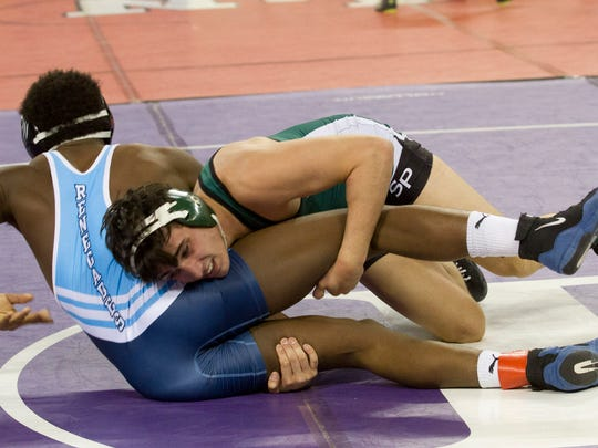 South Plainfield's Daniel Hedden goes for a takedown on Shawnee's Isaiah Bryant during their 152 lbs match. Friday night Pre-Quarters round at NJSIAA State Wrestling Tournament in Atlantic City, NJ on March 4, 2016
