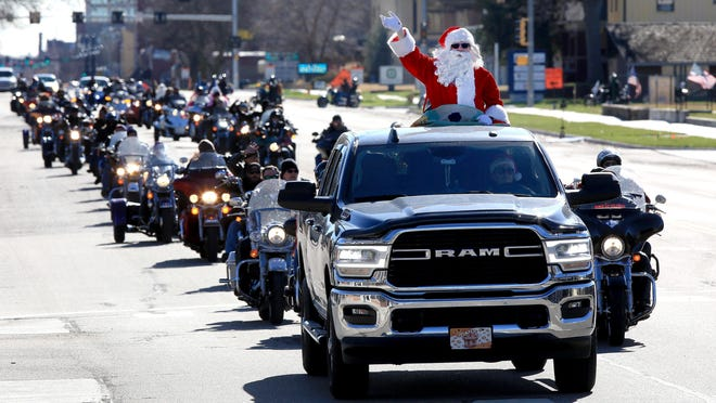 Santa Claus leads the way as motorcyclists participate in the annual Reno County Toy Run Sunday afternoon. The Toy Run is an event for people to donate toys, bicycles and money to the Salvation Army for distribution at Christmas to children in the community.