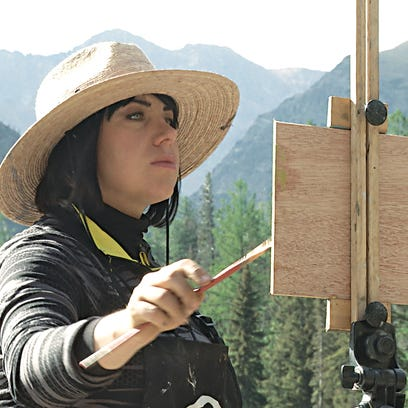 Rachel Warner paints in the Two Medicine area of Glacier