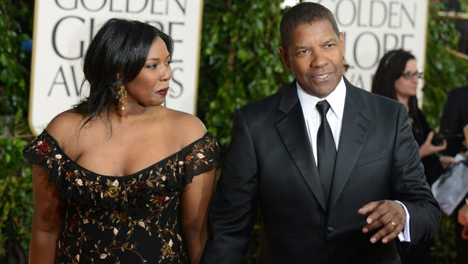 In a Sunday Jan. 13, 2013, photo, actor Denzel Washington (R) and his daughter Olivia Washington arrive at the 70th Annual Golden Globe Awards at the Beverly Hilton Hotel, in Beverly Hills, Calif.