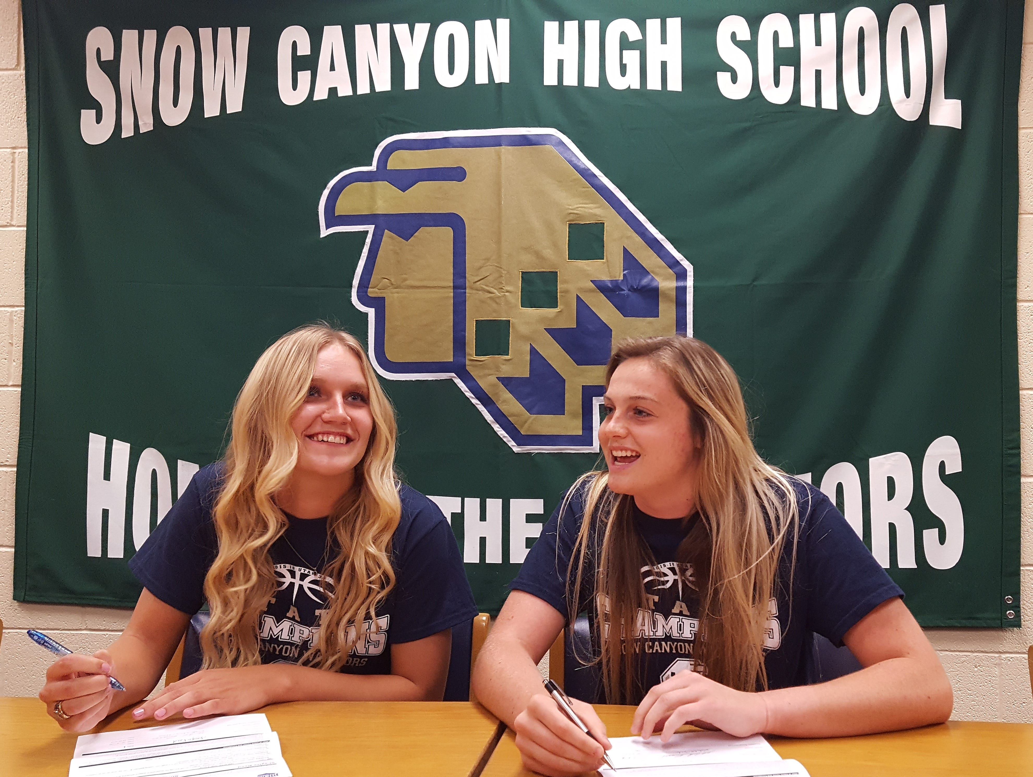 Snow Canyon's Shaylee Reed (left) and Mada Mooring (right) sign their Letters of Intent to Snow College on Friday.