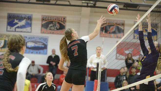 Manitowoc Lutheran's Emily Behnke (7) has been a key player for the Lancers in the last month since being called up from JV 1.