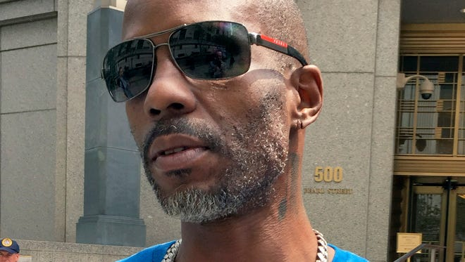 In this Aug. 11, 2017, file photo, rapper DMX, whose given name is Earl Simmons, leaves federal court in New York. In a court document made public Monday, March 26, 2018, an attorney for DMX said he plans to use music to convince a judge that his client deserves leniency for his tax evasion conviction. (AP Photo/Larry Neumeister, File)