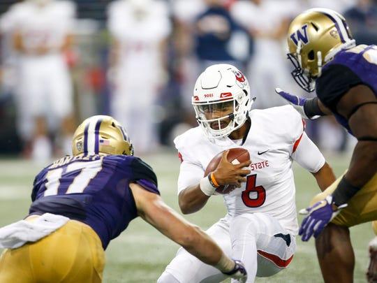 Sep 16, 2017; Seattle, WA, USA; Fresno State Bulldogs quarterback Marcus McMaryion (6) is tackled for a loss by Washington Huskies linebacker Tevis Bartlett (17) during the third quarter at Husky Stadium. Mandatory Credit: Joe Nicholson-USA TODAY Sports