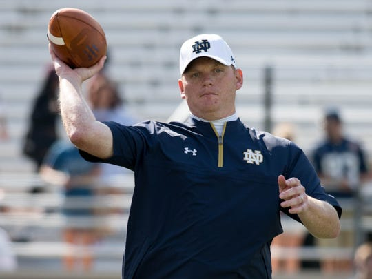 Notre Dame Fighting Irish offensive coordinator Chip Long throws a ball during warmups before the game against the Boston College Eagles at Alumni Stadium.