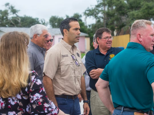 Texas Land Commissioner George P. Bush speaks with Coastal Bend Officials about new funding to repair affordable rental housing complexes in the coastal bend as he stands outside the Oak Harbor Apartments in Rockport on Friday, July 6, 2018.
