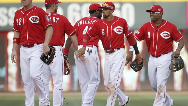 The Cincinnati Reds celebrate a win May 30 against the Washington Nationals.