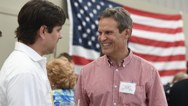 Nathan Buttery talks with gubernatorial candidate Bill Lee at the Williamson County Republican's annual BBQ Saturday, July 15, 2017, in Thompson Station, Tenn.