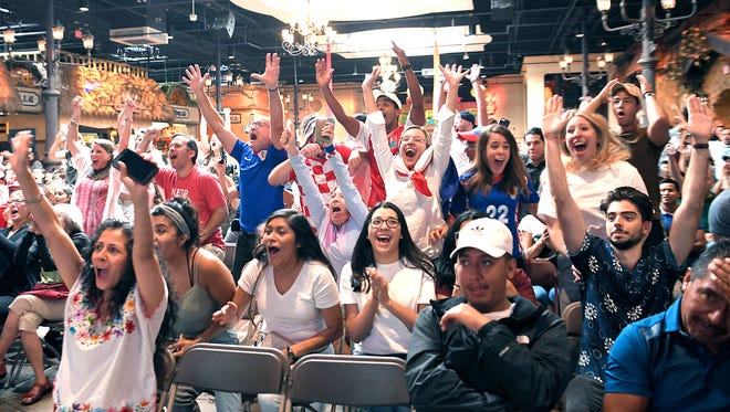 During a World Cup watch party at Plaza Mariachi, Croatia fans cheer after Croatia scored on Sunday, July 15, 2018.