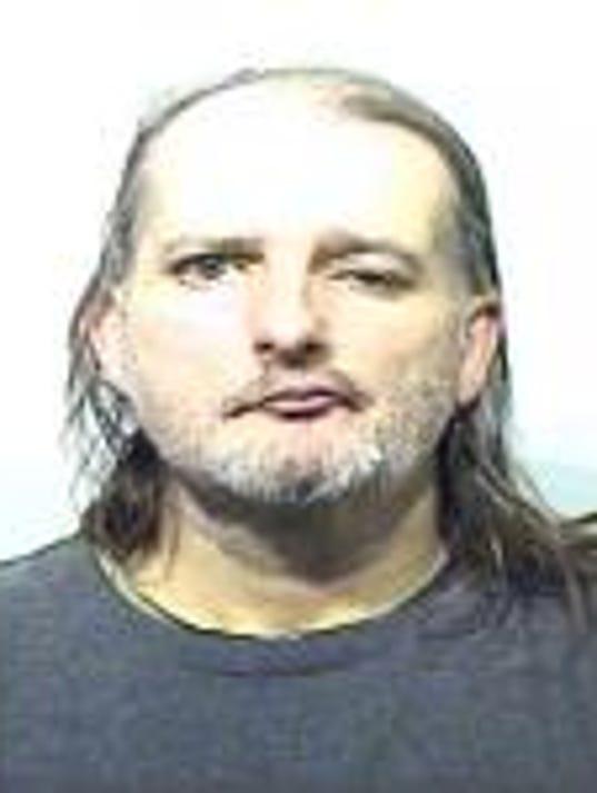 636180035063853860-Miller-arrest-photo.jpg