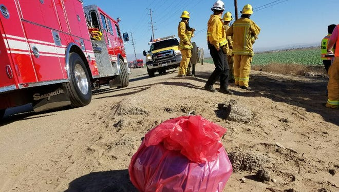 A bag of materials is set aside for further investigation after a hazardous-materials incident Thursday morning at Los Duraznos Ranch. The incident caused the closure of Wood Road.
