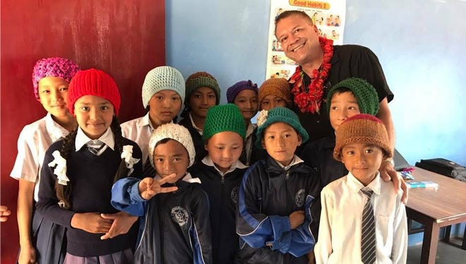 Students in Nepal wear their new hats made by Concho Valley residents for Terry Mikeska's mission trip.