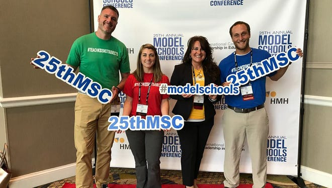 Port Clinton Middle School was honored at the National Model Schools Conference in Nashville. From left are Lucas Messer, assistant principal; Anna Orians, language arts; Carrie Sanchez, principal, and Ryan Evarts, social studies.
