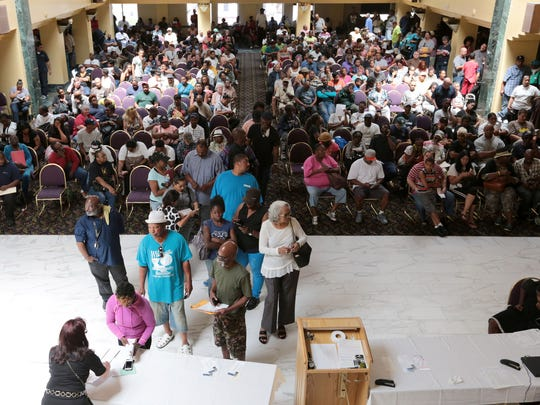 People crowd into the ballroom at 400 Monroe in Greektown in Detroit on June 30, 2016, to pay their back taxes or make arrangements for a payment plan with the Wayne County Treasurer's office.
