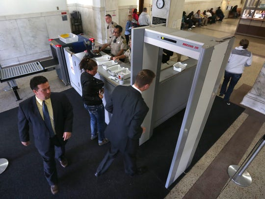 Visitors to the Polk County Courthouse pass through