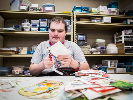 Employees create card and pottery products to sell