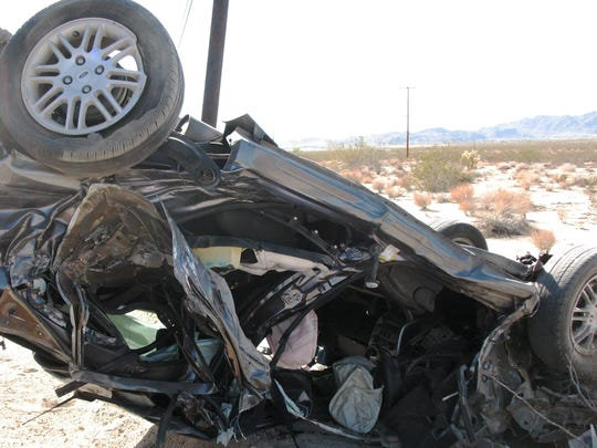 A mangled Ford Focus sits on the side of Highway 62 on April 19, 2013. The driver of this vehicle, Kristin April Thrawl, 26, was killed when a Marine Corps Humvee crossed the center line and crashed into her car. The Marines were uninjured.