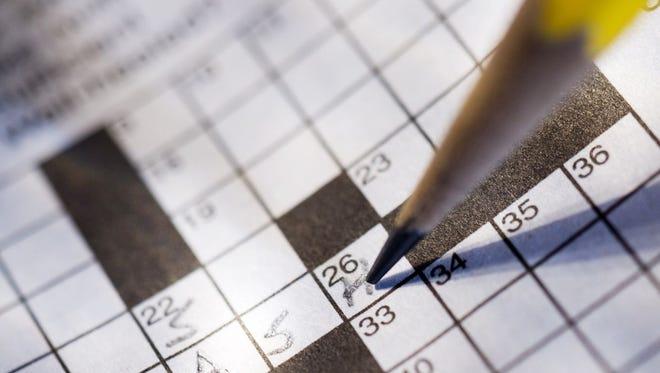 Crossword puzzles keep the brain active.  Thinkstock Financial crossword puzzle. Credit: Thinkstock