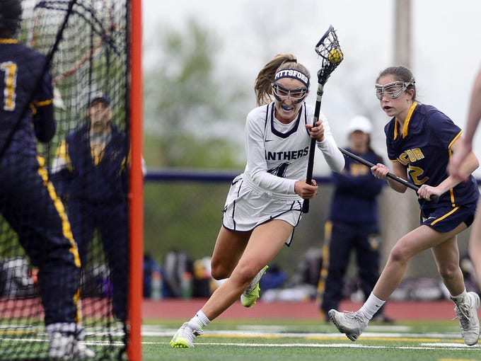 Pittsford's Jillie Quevedo, center, drives to the goal